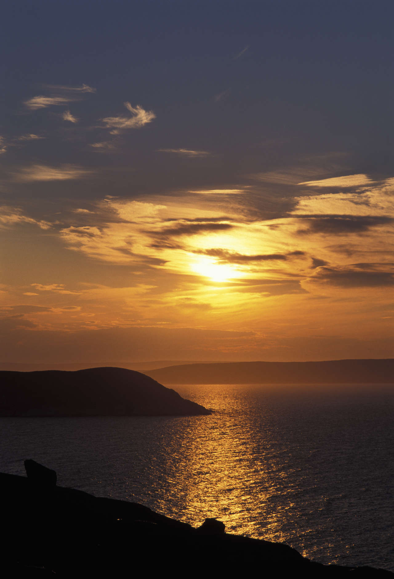Midnight Sun at the reflecting in the sea at the North Cape © Trym Ivar Bergsmo