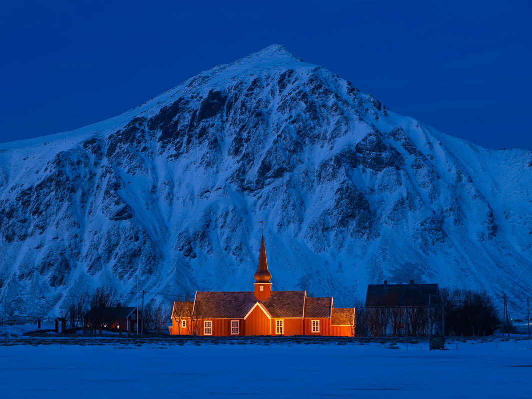 Flakstad church in Lofoten lit during the blue hour © Bård Løken