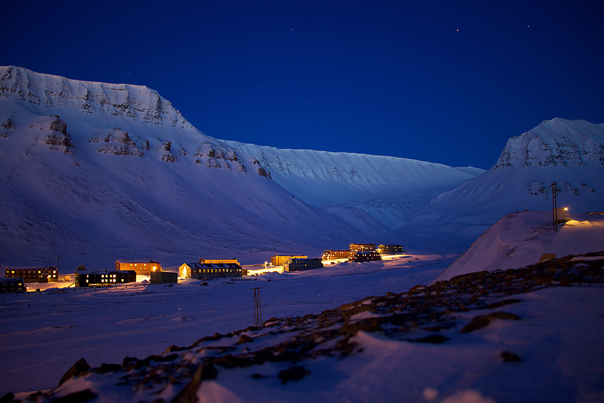 "Nybyen (literally, ""the new town"" in Longyearbyen in blue light © Marcela Cardenas"