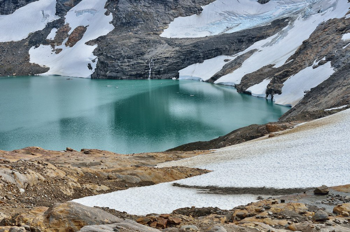 The green blue glacier lake is ice cold (c) Fabrice Milochau