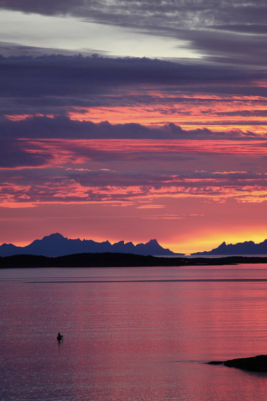 The lofoten islands seen from bodø in the midnight sun in northern norway