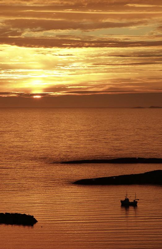 Når sola slåss med skyene om oppmerksomheten © Tore Schöning Olsen