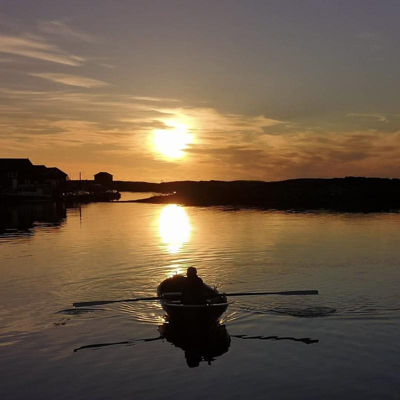 Port of Lovund in the Midnight Sun