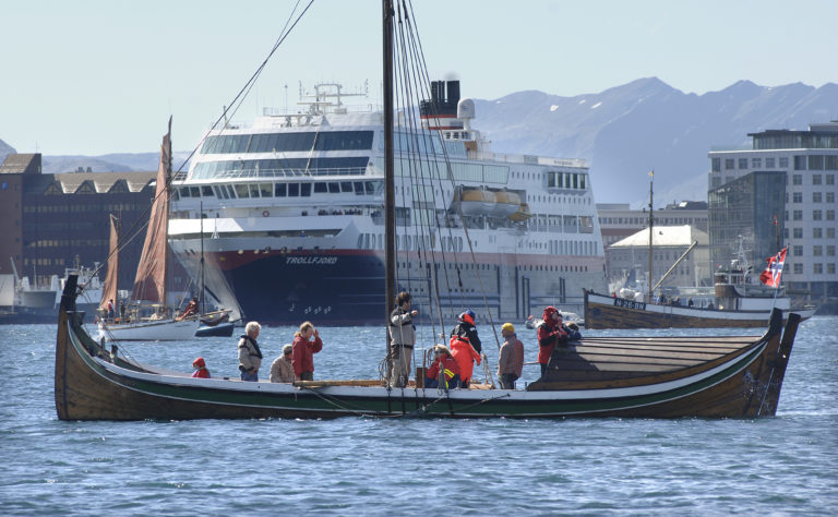 A Nordland Boat making its wayalong the coast of Bodø, with the Hurtigruten boat nearby © Ernst Furuhatt