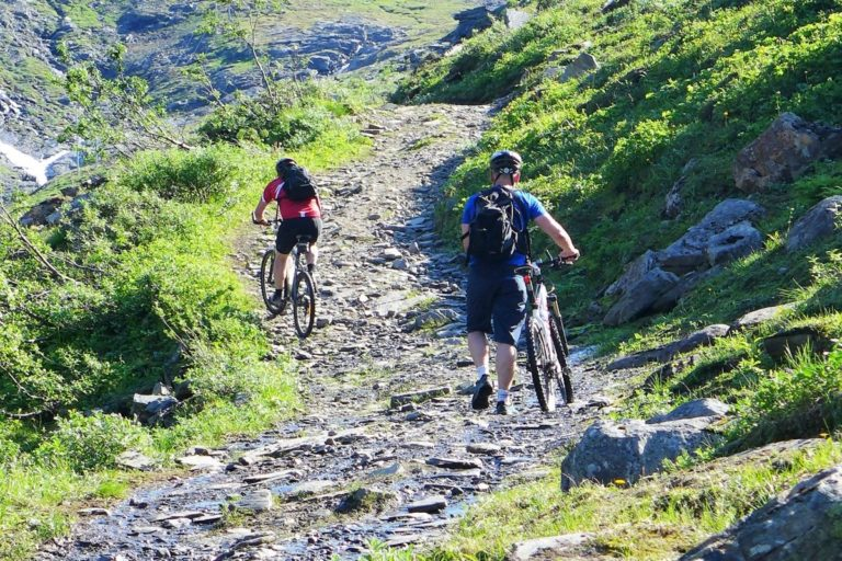There's no shame in some of the tougher uphill sections to get off your bike and walk with it © Georg Sichelschmidt - Visit Lyngenfjord