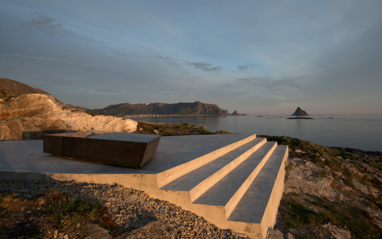 Kleivodden viewpoint at Andøya in the light of the Midnight sun. The fishing village of Bleik and the conic Bleiksøya are in the far back © Roger Ellingsen