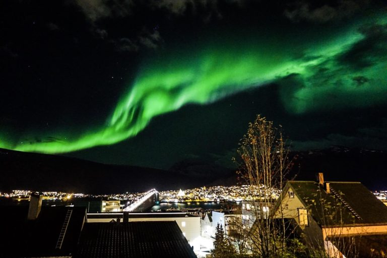 The Northern Lights see about two streets up from the main street of Tromsø © Knut Hansvold