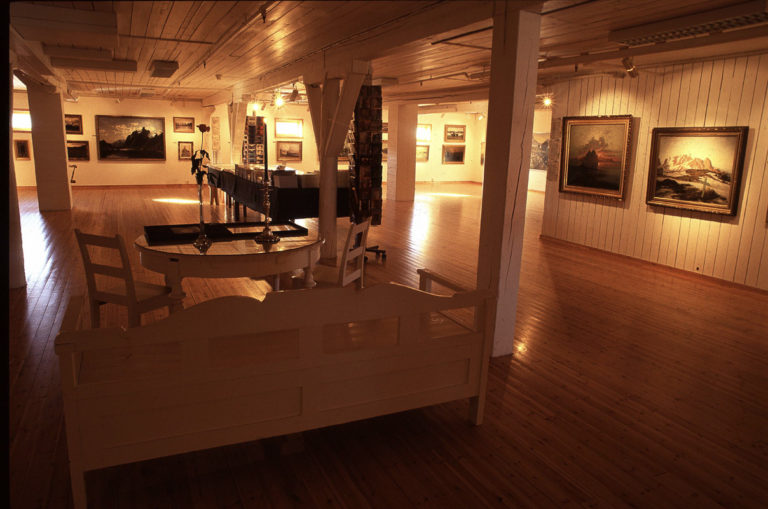 The gallery has seating to sit and admire the artworks © Knut Hansvold