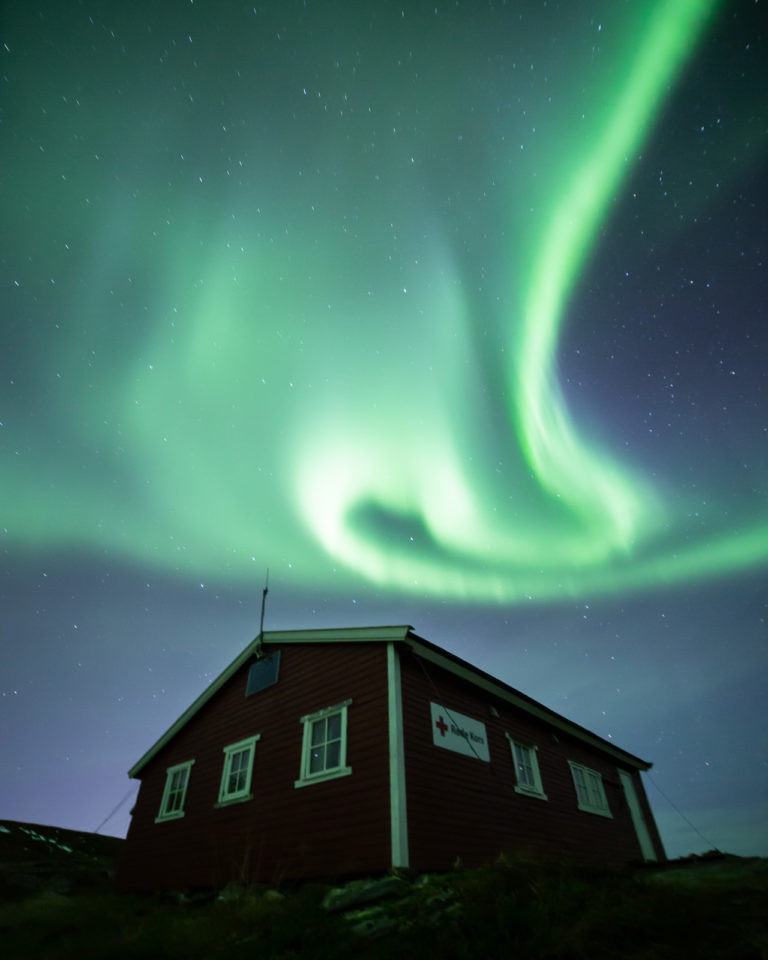 Aurora swirling over one of the cabins © William Copeland""