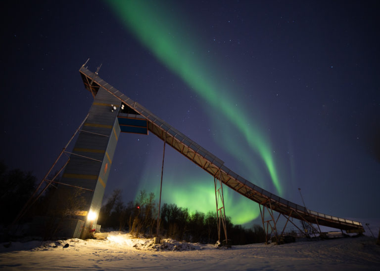 The largest ski jump with northern lights to the north © William Copeland