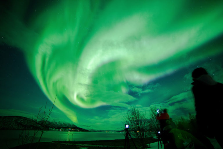 The aurora colouring the Balsfjord green, taken from the old road © William Copeland