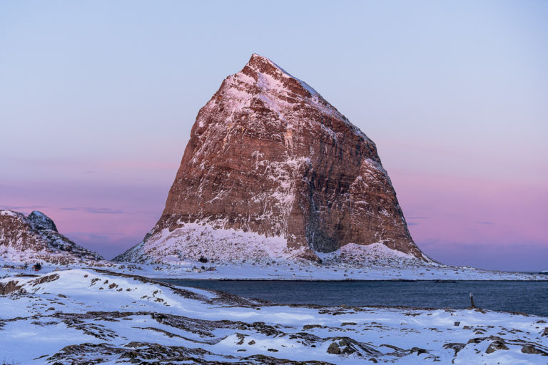 Mount Trænstaven in reddish winter light. The Trænstaven at 338 metres can only be climbed with ropes, but there are lots of other nice tours on the island of Sanna © Arvids Baranovs