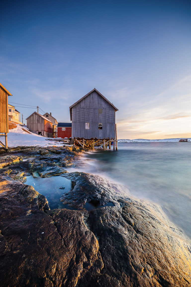 The winter light plays with the boat house and warehouse walls in Træna © Arvids Baranovs