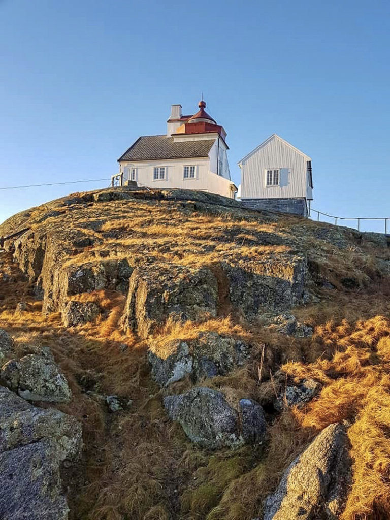 The grass is brown in winter at Myken lighthouse, found on its own islet at the fishing village of Myken © Myken fyr