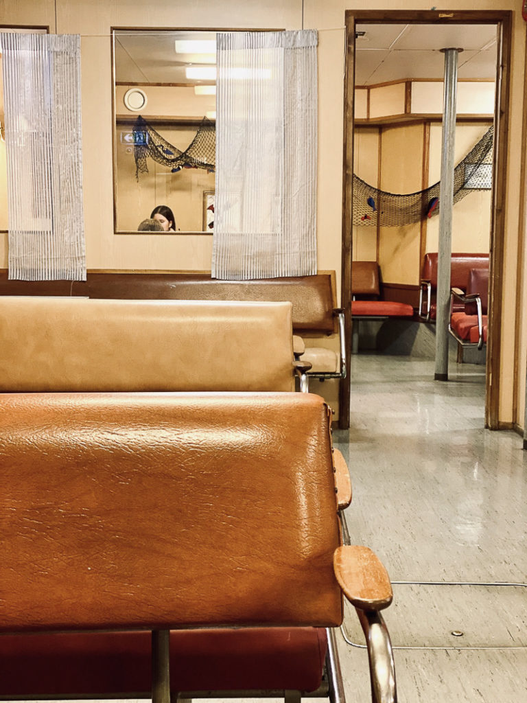 Solid benches and worn linoleum, an old fashioned ferry cafe under the car deck © Kathrine Sørgård