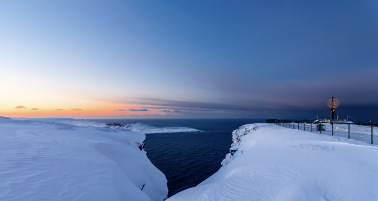 Winter light at the North Cape. Cape Knivskjelodden, being almost a mile further north (don't tell anyone!), you see right in the middle © Kjell Bendik Pedersen