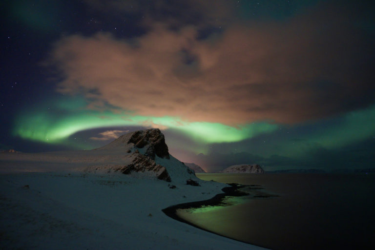 Northern Lights over arctic coasts at the Magerøya Island ©www.71-nord.no
