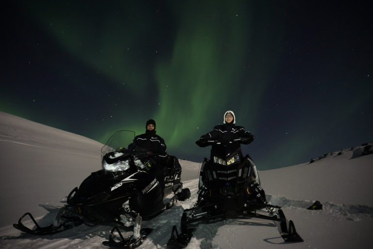 The landscape on Magerøya Island is made for snowmobiling, with low, rolling hills and valleys. However, the Northern Lights bring the tour to a full stop ©www.71-nord.no