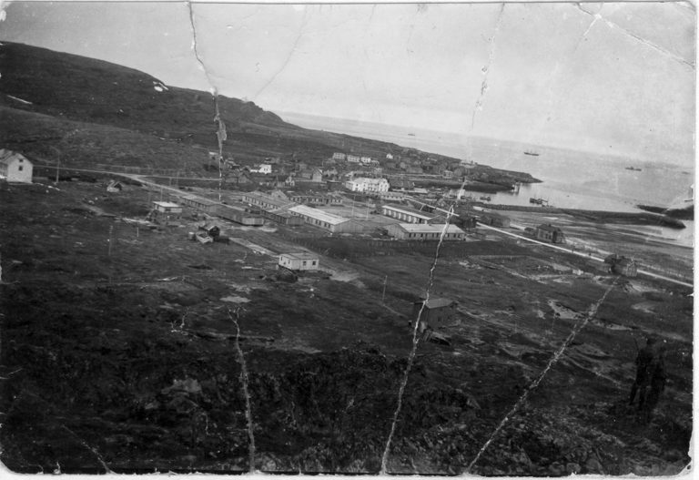 View of Kiberg during the war. The village itself is in the background, and the dominant Nazi establishments are in the centre