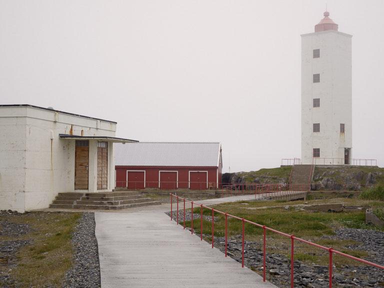 Kjølnes lighthouse near Berlevåg in chilly ocean fog © Emile Holba / www.visitvaranger.no