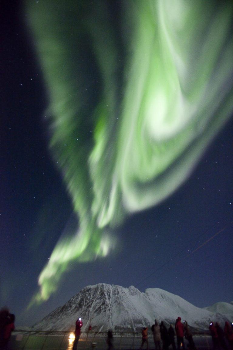 The Northern Lights in the Kågsundet narrows near Skjervøy, seen from the deck of the Hurtigruten © Shigeru Ohki